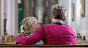 17/06/15 A woman and her child pray for the victims after signing the Book of Condolences which was opened for the victims of the California balcony collapse at Our Lady of Perpetual Succour Church, Foxrock this afternoon...Picture Colin Keegan, Collins Dublin.