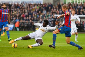 Wilfried Bony shoots past Crystal Palace defender Brede Hangeland to score for Swansea City during their Premier League clash at the Liberty Stadium. Photo: Mike Hewitt/Getty Images