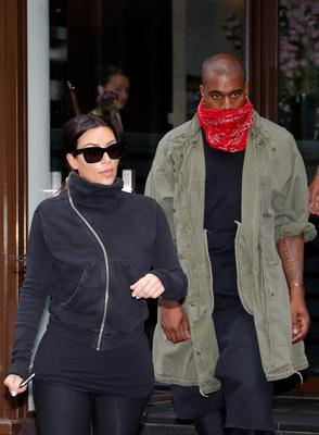 TV personality Kim Kardashian and rapper Kanye West leave a fitness club in Paris May 21, 2014.  REUTERS/Gonzalo Fuentes
