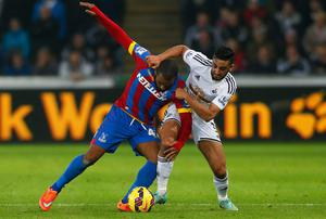 Swansea City defender Neil Taylor tussles with Crystal Palace's Jason Puncheon during their Premier League clash at the Liberty Stadium. Photo: Harry Engels/Getty Images