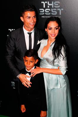Cristiano Ronaldo, his son Cristiano Ronaldo Junior and Georgina Rodriguez arrive for The Best FIFA Football Awards - Green Carpet Arrivals on October 23, 2017 in London, England.  (Photo by Michael Steele/Getty Images)