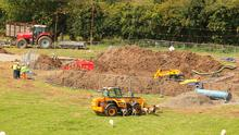 Work goes on at the site of the pipe leakage at Rough Grange, Donore, Drogheda, yesterday afternoon. Photo: Collins Photos