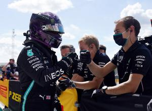 Mercedes' Lewis Hamilton celebrates with his team after qualifying in pole position for the Formula One British Grand Prix at Silverstone, England. Photo: Will Oliver/Reuters