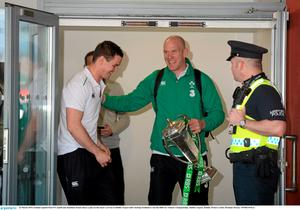 Paul O'Connell and Jonathan Sexton share a joke on the team's arrival at Dublin Airport. Photo: Brendan Moran / SPORTSFILE