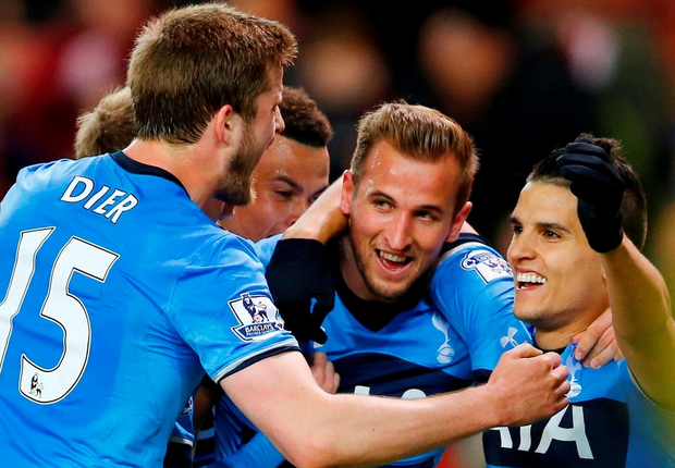 Harry Kane celebrates with team mates after scoring the third goal for Tottenham .Reuters / Darren Staples
