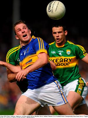 14 June 2015; Peter Acheson, Tipperary, in action against Bryan Sheehan, Kerry, behind. Munster GAA Football Senior Championship Semi-Final, Kerry v Tipperary. Semple Stadium, Thurles, Co. Tipperary. Picture credit: Seb Daly / SPORTSFILE