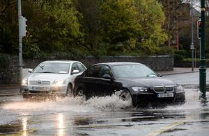 Traffic driving through floods on corner of Howth road and Clontarf road
