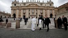 Pope Francis (C) leaves at the end of the general audience in St. Peter's Square at the Vatican March 4, 2015.