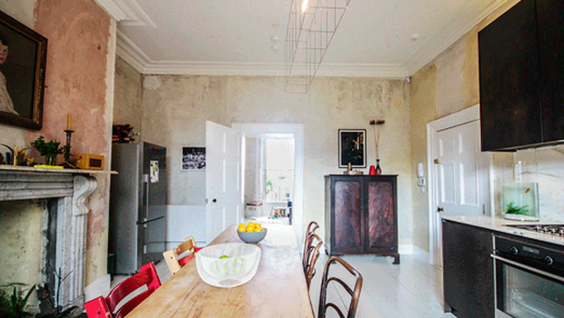 Esther Gerrard and Ed Coveney's duplex apartment: The contemporary kitchen with its restored sash window