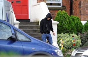Luis Suarez leaving his home yesterday as the controversy over his bite gathered pace