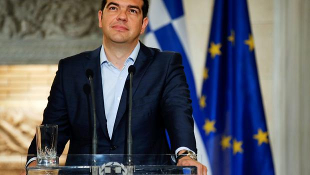 """Greek Prime Minister Alexis Tsipras looks up during a news conference with Austrian Chancellor Werner Faymann at Maximos Mansion in Athens June 17, 2015. The Greek central bank warned on Wednesday that the country would be put on a """"painful course"""" towards default and exiting the euro zone if the government and its international creditors failed to reach an agreement on an aid-for-reforms deal.  REUTERS/Paul Hanna"""