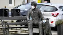 Model citizens: A statue with masks and a bottle of hand sanitiser in Rathdrum, Co Wicklow. Photo: Garry O'Neill