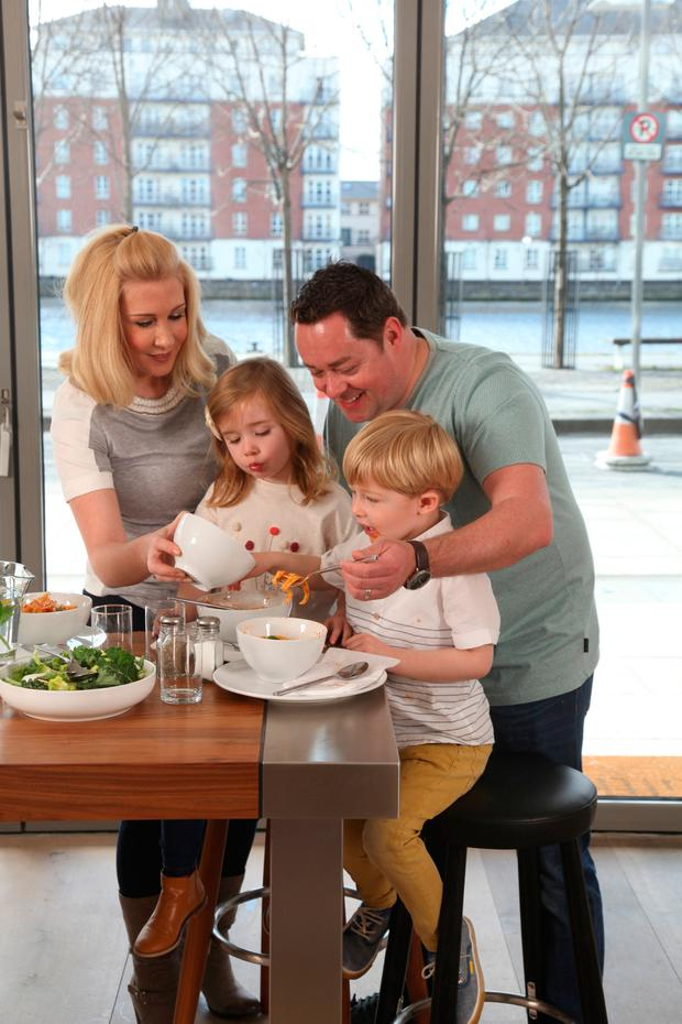 Neven, pictured with his wife Amelda with their twins, Lucia and Connor, believes you should involve children in cooking as early as possible. Photo: Paul Sherwood