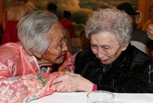 South Korean Lee Young-shil, 87, right, meets with her North Korean sister Lee Jong Shil, 84, during the Separated Family Reunion Meeting