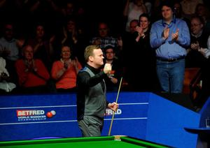 Shaun Murphy celebrates beating Barry Hawkins in their semi final match during day fifteen of the Betfred World Championships at the Crucible