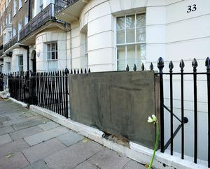 Flowers are left at the scene in Montagu Square, Marylebone, London, after bankrupt tycoon Scot Young, died after reportedly falling on to railings at the upmarket London property. Mr Young, 52, known for fighting a long legal battle with his ex-wife over a multimillion-pound settlement, died on Monday evening (Louisa Collins-Marsh/PA Wire)