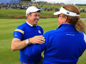 Europe's Lee Westwood and Miguel Angel Jimenez celebrate after winning the Ryder Cup on day three of the 40th Ryder Cup at Gleneagles Golf Course, Perthshire. PRESS ASSOCIATION Photo. Picture date: Sunday September 28, 2014. Photo credit should read: Mike Egerton/PA Wire. RESTRICTIONS: Use subject to restrictions. Editorial use only. No commercial use. Call +44 (0)1158 447447 for further information.