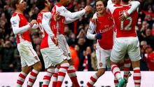 Arsenal's Alexis Sanchez (2nd R, partially obscured) celebrates his second goal with teammates