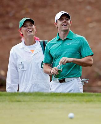 Tennis player Caroline Wozniacki stands next to her fiancee Rory McIlroy, of Northern Ireland, during the par three competition at the Masters golf tournament Wednesday, April 9, 2014, in Augusta, Ga. (AP Photo/Matt Slocum)