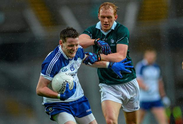 Monaghan's Conor McManus holds off a challenge from Keith Cribbin of Kildare during the All-Ireland qualifier at Croke Park. Photo: Piaras O Midheach / SPORTSFILE