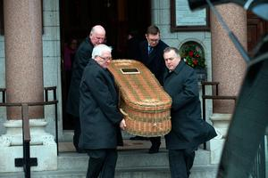 The coffin is removed from the church at the funeral of former Pogues manager Frank Murray in St Paul's Church, Mount Argus. Photo: Tony Gavin