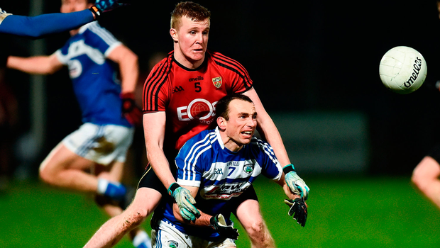 Gareth Dillon of Laois  in action against Stephen Fegan of Down. Photo by Oliver McVeigh/Sportsfile