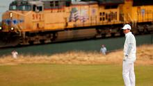 Rory McIlroy waits on the 16th green as a train passes during the first round of the US Open Championship at Chambers Bay yesterday