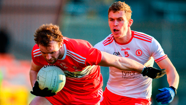 Padraig Cassidy of Derry in action against Ben McDonnell of Tyrone. Photo by Sam Barnes/Sportsfile