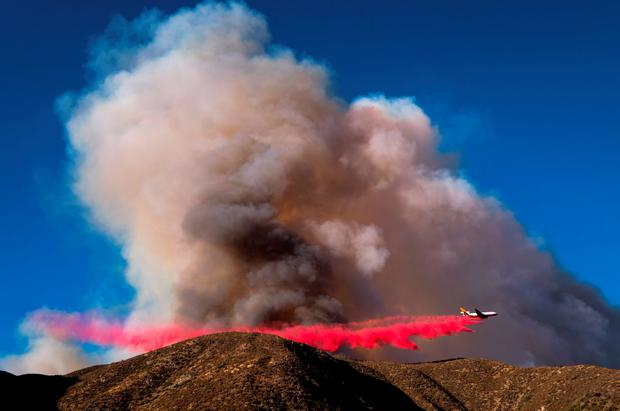 An air tanker drops fire retardant on the Blue Cut wildfire in Lytle Creek, California, August 16, 2016.