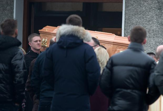 The remains of Noel Whelan are brought from St. Joseph's Church, Bonnybrook, Dublin after his funeral mass.