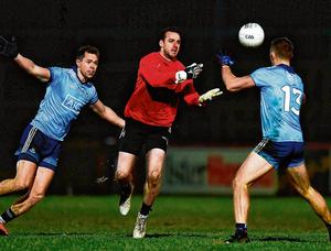Tyrone's Niall Morgan, in action against Dublin's Paul Mannion and Dean Rock last Saturday night, is one of the goalkeepers who utilises immediately linking up with his defence off one of his own kick-outs. Photo: David Fitzgerald/Sportsfile