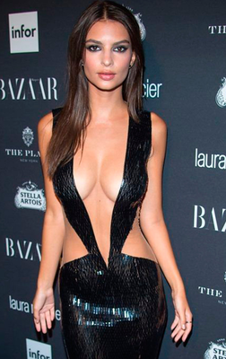 Wide-eyed: Emily Ratajkowski in the Julien Macdonald gown that plunged beyond her navel