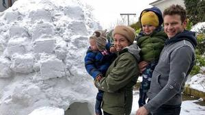 The Campbell family with their igloo creation