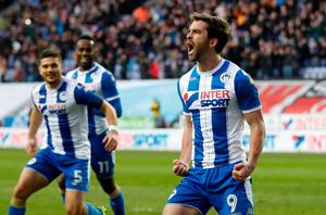 Wigan Athletic's Will Grigg celebrates scoring their second goal