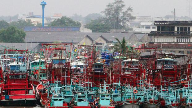 Fishing boats are seen docked at a port as tropical storm Pabuk approaches the southern province of Pattani, Thailand, January 3, 2019. REUTERS/Surapan Boonthanom