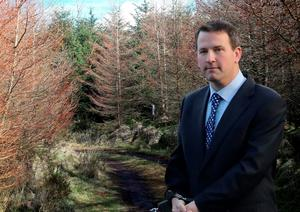Graham Dwyer being taken from court in handcuffs. In the background is Killakee Woods, where Elaine O Hara's remains were found