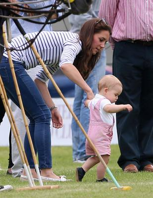 June 2014: Catherine, Duchess of Cambridge and Prince George of Cambridge attend the Royal Charity Polo during the Maserati Jerudong Trophy at Cirencester Park Polo Club on June 15, 2014