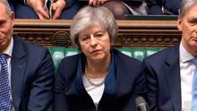 Prime Minister Theresa May listens to Labour leader Jeremy Corbyn speaking after losing a vote on her Brexit deal in the House of Commons, London. Tuesday January 15, 2019. Photo: PA Wire
