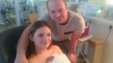 Photo issued by the Sick Childrens Trust, of Lauren Smith, 23 and partner Graham Lucas, 27, from Peterborough, with surviving twin daughter Ava, after they were advised to turn of Elouises life support machine 18 hours after she was born. Photo credit: Family Handout/PA Wire