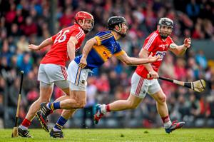 Conor O'Brien, Tipperary, in action against Bill Cooper, Cork