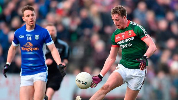 Mayo's Danny Kirby in action against Cavan's Conor Madden. Photo: David Maher/Sportsfile