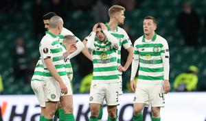 Celtic's Greg Taylor and teammates look dejected at the end of the match