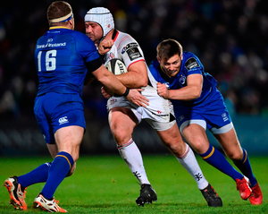 Ulster's Rory Best is tackled by Seán Cronin, left, and Ross Byrne of Leinster. Photo: David Fitzgerald/Sportsfile