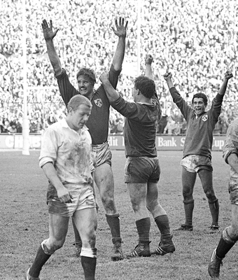 RELIEF: Ireland players Willie Anderson (l), Jim McCoy and Michael Bradley (r) celebrate winning the Triple Crown against England in the Five Nations Rugby Championship at Lansdowne Road in March 1985. Picture credit: Ray McManus / Sportsfile