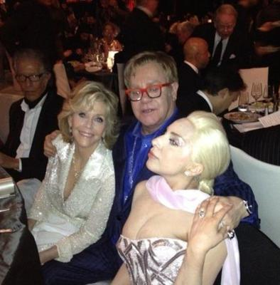 Elton John greets his guests Jane Fonda and Lady Gaga