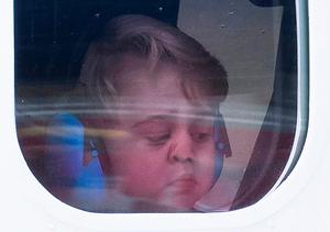 Prince George onboard after a ceremony to mark the departure of the royal visit to Canada at Victoria Harbour seaplane terminal.