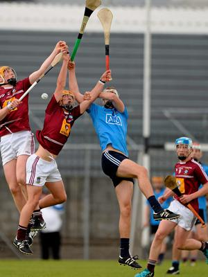Niall Mitchell, right, and James Bermingham up against Dublin's Eoghan Conroy