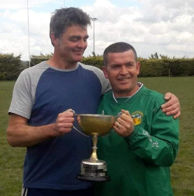 Club president Liam McCarthy (right) celebrating with coach Neil Sanders after the Kelly Cup victory last year