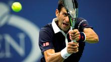 Novak Djokovic of Serbia hits the ball to Feliciano Lopez of Spain during their quarterfinal match at the U.S. Open Championships tennis tournament in New York