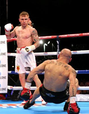 Carl Frampton reacts after knocking down Kiko Martinez during their IBF World Super Bantamweight Championship fight in the Titanic Quarter, Belfast. PRESS ASSOCIATION Photo. Picture date: Saturday September 5, 2014. Photo credit should read: Niall Carson/PA Wire